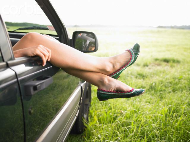 Woman Hanging Legs out Car Window --- Image by © Morgan David de Lossy/Corbis