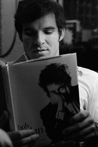 Steve Martin Reading Book About Bob Dylan